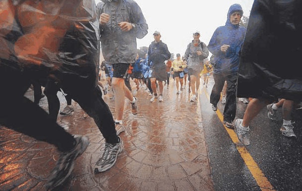 The second wave of Pikes Peak Ascent runners got off to a wet start Saturday in downtown Manitou Springs. More than half the field didn't finish the 13.32 mile race—either by their own choice or because officials turned them back because of bad weather above treeline.