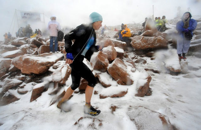 Brandy Erholtz of Bailey was the first female finisher of the Pikes Peak ascent on Saturday. Simon Gutierrez of Alamosa captured his third ascent title for the men.