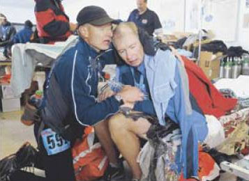 Samuel Fancher, left, of Colorado Springs gave first aid to his brother Lincoln Fancher of Lacona, N.Y., after the race.