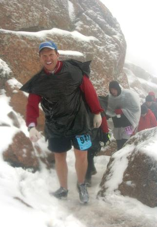 Justin Gadberry, a 26-year-old Fenton resident, battles slush, cold temperatures and wind on his way to the summit during the Pikes Peak Ascent on Aug. 16. He finished the 13.32-mile race in four hours and 20 minutes. The course climbs more than 7,800 feet.