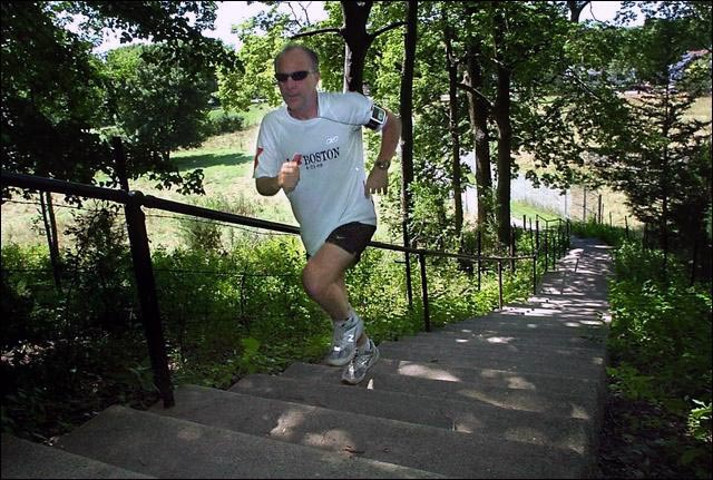 Jim Wiese runs up the 240 stairs that lead to the top of Good Counsel hill as part of his training for today's Pikes Peak Marathon in Colorado.