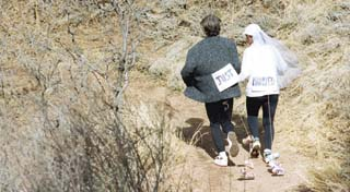 World-class runner Matt Carpenter sprints Sunday down Waldo Canyon Trail with his new bride, the former Yvonne Franceschini. Pop cans jostle behind the newlyweds.