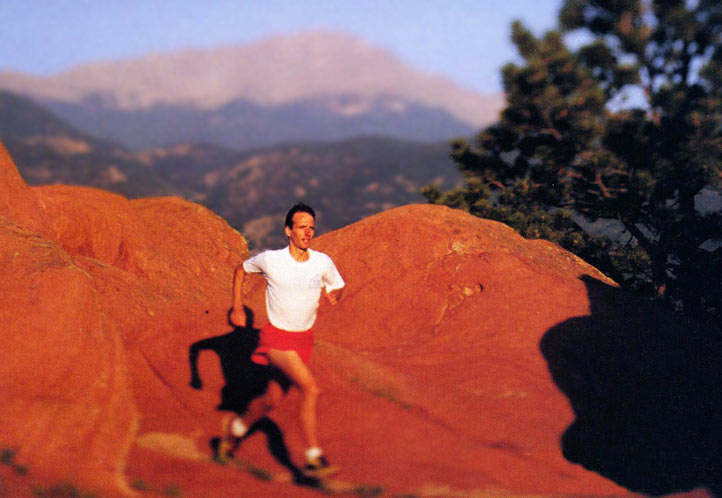 Matt Carpenter runs in the Garden of the Gods near his home in Manitou Springs, Colorado, with his beloved Pikes Peak in the background.
